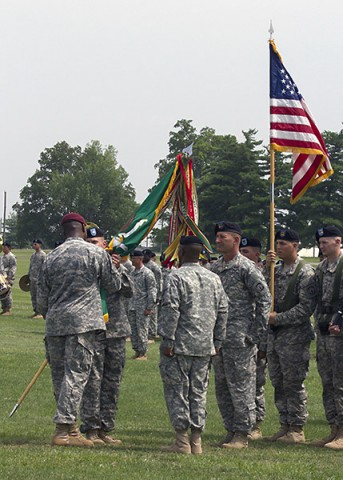 Lt. Col. Michael Johnston, incoming commander of the 716th Military Police Battalion, 101st Sustainment Brigade, 101st Airborne Division (Air Assault), takes the unit colors from Col. Alexander Conyers, commander of the 16th Military Police Brigade, during a change of command ceremony June 25, 2015, at the division parade field here. (Sgt. 1st Class Mary Rose Mittlesteadt, 101st Sustainment Brigade, 101st Airborne Division Public (Air Assault) Public Affairs)