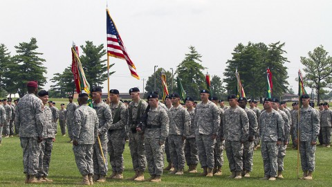 The leadership of the 716th Military Police Battalion, 101st Sustainment Brigade, 101st Airborne Division (Air Assault), prepares to ceremoniously pass the unit colors, representing the passing of leadership and responsibility, during a change of command ceremony June 25, 2015, at the division parade field here. Lt. Col. Leevaine Williams Jr., after two years commanding the Peacekeepers, relinquished his command to Lt. Col. Michael Johnston in the traditional ceremony. (Sgt. 1st Class Mary Rose Mittlesteadt, 101st Sustainment Brigade, 101st Airborne Division Public (Air Assault) Public Affairs)