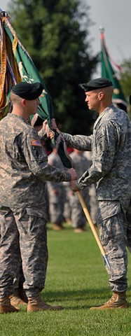 Brig. Gen. Darsie D. Rogers, the commanding general of 1st Special Forces Command (Airborne) (Provisional), passes the 5th Special Forces Group (Airborne) colors to Col. Kevin C. Leahy, 5th SFG (A) commander, during the 5th Special Forces Group (Airborne) change of command ceremony on Gabriel Field July 16, 2015. (Sgt. Jacob Mahaffey, 5th SFG(A) Public Affairs)