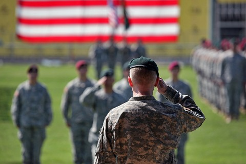 Col. Kevin C. Leahy, commander of the 5th Special Forces Group (Airborne), salutes his formation during the closing of the 5th SFG(A) change of command ceremony on Gabriel Field, July 16, 2015. (Sgt. Seth Plagenza, 5th SFG(A) Combat Camera)