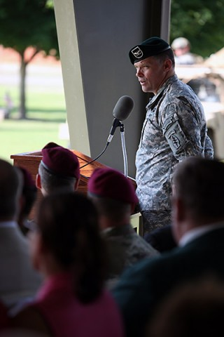 Col. John W. Brennan, outgoing commander of the 5th Special Forces Group (Airborne), speaks to Soldiers, family members and friends during the 5th SFG(A), change of command ceremony on Gabriel Field, July 16, 2015. (Sgt. Seth Plagenza, 5th SFG(A) Combat Camera)