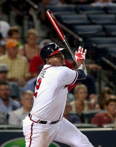 Atlanta Braves third baseman Juan Uribe (2) singles on a fly ball scoring a run in the fifth inning of their game against the Los Angeles Dodgers at Turner Field. (Jason Getz-USA TODAY Sports)