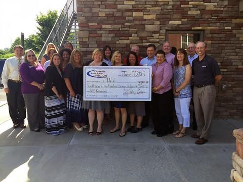 Clarksville Association of REALTORS check presentation to F.U.E.L.