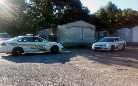 Clarksville Police Officers investigate shots fired at Prewitt's Mobile Home Park.