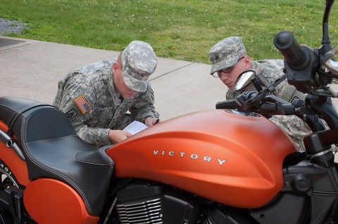 Sgt. Andrey Kolomiytsev and Sgt. Clayton Russell both with the 2nd Battalion, 44th Air Defense Artillery Regiment, 101st Sustainment Brigade, 101st Airborne Division, conduct an inspection on a motorcycle during pre-riding check and training session to kick off the Motorcycle Safety Month on May 6, 2015. (Sgt. 1st Class Mary Rose Mittlesteadt, 101st Sustainment Brigade, 101st Airborne Division Public (Air Assault) Affairs)
