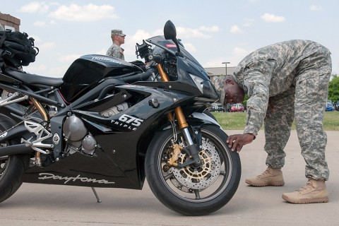Sgt. 1st Class Guy Taylor, the logistics noncommissioned officer in charge with 101st Special Troops Battalion, 101st Sustainment Brigade, 101st Airborne Division, conducts an inspection on his battle buddies motorcycle during an inspection and training session to kick off the Motorcycle Safety(Sgt. 1st Class Mary Rose Mittlesteadt, 101st Airborne Division Public (Air Assault) Affairs)