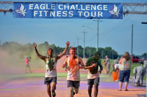 Spc. Ali Karim, Pvt. Andrew Neuman and Pvt. Christian Martinez, all Soldiers with 3rd Battalion, 187th Infantry Regiment, 3rd Brigade Combat Team, 101st Airborne Division (Air Assault), cross the finish line at the conclusion of the color run here July 18, 2015. The color run took place as part of the Eagle Challenge Fitness Tour. (Staff Sgt. Sierra Fown 2nd Brigade Combat Team, 101st Airborne Division (AA) Public Affairs)