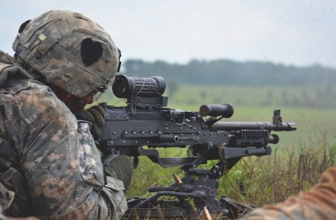 A Soldier with 2nd Battalion, 502nd Infantry Regiment, 2nd Brigade Combat Team, 101st Airborne Division, fires a squad automatic weapon during the Strike Brigade's walk and shoot here, July 23, 2015. The walk and shoot was a month long training event that took place in order to prepare the brigade for its' upcoming Joint Readiness Training Center rotation. (Staff Sgt. Sierra A. Fown, 2nd Brigade Combat Team, 101st Airborne Division (Air Assault) Public Affairs)