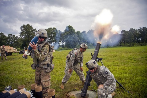 Forward Observers with 1st Battalion, 320th Field Artillery Regiment, Division Artillery, 101st Airborne Division, fire a mortar during the walk and shoot here, July 23, 2015. The walk and shoot was a month long training event that took place in order to prepare the 2nd Brigade Combat Team, 101st Abn. Div., for it's upcoming rotation at the Joint Readiness Training Center, Fort Polk, LA. (Staff Sgt. Terrance D. Rhodes, 2nd Brigade Combat Team, 101st Airborne Division (AA) Public Affairs)