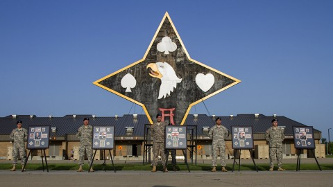 Members of the 101st Special Troops Battalion, 101st Sustainment Brigade, 101st Airborne Division (Air Assault), stand next to photos of five 101st STB Soldiers who were killed during an insider attack at Forward Operating Base Gamberi, Laghman Province, Afghanistan, on April 16, 2011. (Sgt. 1st Class Mary Rose Mittlesteadt, 101st Sustainment Brigade, 101st Airborne Division (Air Assault) Public Affairs)