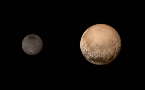 A portrait from the final approach. Pluto and Charon display striking color and brightness contrast in this composite image from July 11, showing high-resolution black-and-white LORRI images colorized with Ralph data collected from the last rotation of Pluto. Color data being returned by the spacecraft now will update these images, bringing color contrast into sharper focus. (NASA-JHUAPL-SWRI)