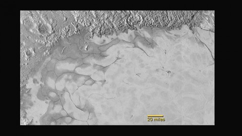 New Horizons discovers flowing ices in Pluto's heart-shaped feature. In the northern region of Pluto's Sputnik Planum (Sputnik Plain), swirl-shaped patterns of light and dark suggest that a surface layer of exotic ices has flowed around obstacles and into depressions, much like glaciers on Earth. (NASA/JHUAPL/SwRI)