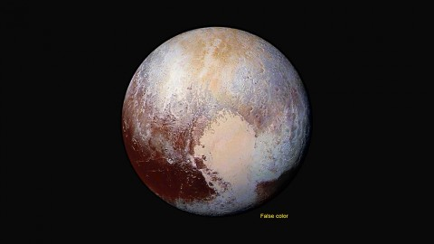 Four images from New Horizons' Long Range Reconnaissance Imager (LORRI) were combined with color data from the Ralph instrument to create this enhanced color global view of Pluto. (The lower right edge of Pluto in this view currently lacks high-resolution color coverage.) The images, taken when the spacecraft was 280,000 miles (450,000 kilometers) away, show features as small as 1.4 miles (2.2 kilometers), twice the resolution of the single-image view taken on July 13. (NASA/JHUAPL/SwRI)
