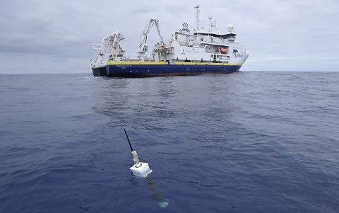 An Argo float, foreground. The new study included direct measurements of ocean temperatures from the global array of 3,500 Argo floats and other ocean sensors. (Argo program, Germany/Ifremer)
