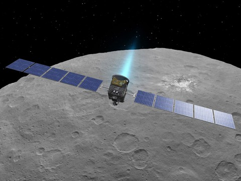 This artist concept shows NASA's Dawn spacecraft above dwarf planet Ceres, as seen in images from the mission. (NASA/JPL-Caltech/UCLA/MPS/DLR/IDA)