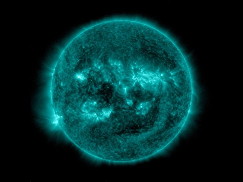 An eruption from the surface of the sun is conspicuous in the lower left portion of this July 6, 2015, image from NASA's Earth-orbiting Solar Dynamics Observatory. (Image credit: NASA)