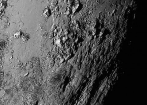 New close-up images of a region near Pluto's equator reveal a giant surprise -- a range of youthful mountains rising as high as 11,000 feet (3,500 meters) above the surface of the icy body. (NASA/JHU APL/SwRI)