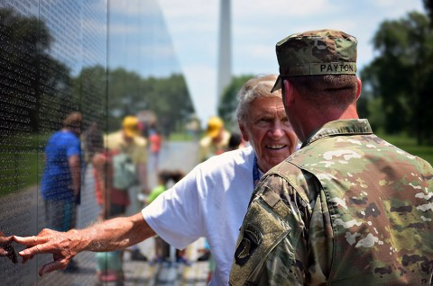 U.S. Marine veteran, Jim Devasher, a Bowling Green, Ky., native, points a name out on the Vietnam War Memorial Wall in Washington July 25, 2015. Staff Sgt. David Payton, 18th Airborne Corps and 101st Airborne Division NCO of the year was the guardian for Devasher during the Screaming Eagle Honor Flight. (Staff Sgt. Sierra A. Fown, 2nd Brigade Combat Team, 101st Airborne Division (Air Assault) Public Affairs)