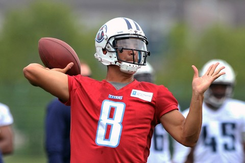 Tennessee Titans first round draft pick quarterback Marcus Mariota (8) passes during OTA drills at Saint Thomas Sports Park. (Jim Brown-USA TODAY Sports)