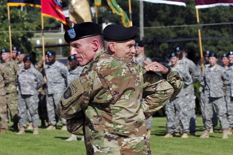 Maj. Gen. Gary J. Volesky, commanding general of the 101st Airborne Division (Air Assault) and Fort Campbell, Ky., welcomes Brig. Gen. John E. Novalis II, deputy commanding general for support of the 101st, during an Honor Eagle ceremony outside of the division headquarters building, Fort Campbell, Ky., Aug. 12, 2015. (Staff Sgt. Matthew W. Ard, 101st Airborne Division (Air Assault) Public Affairs)