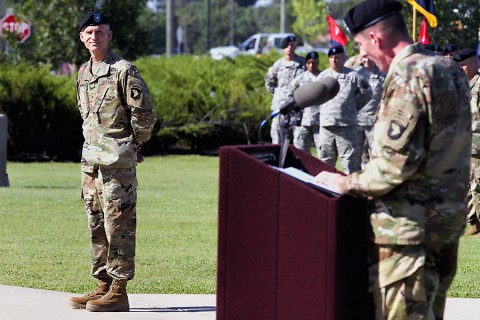 Brig. Gen. John E. Novalis II, deputy commanding general for support, 101st Airborne Division (Air Assault), stands before a formation of Screaming Eagles while being welcomed by Maj. Gen. Gary J. Volesky, commanding general of the 101st and Fort Campbell, Ky., during an Honor Eagle ceremony outside the division headquarters building at Fort Campbell, Aug. 12, 2015. (Staff Sgt. Matthew W. Ard, 101st Airborne Division (Air Assault) Public Affairs)