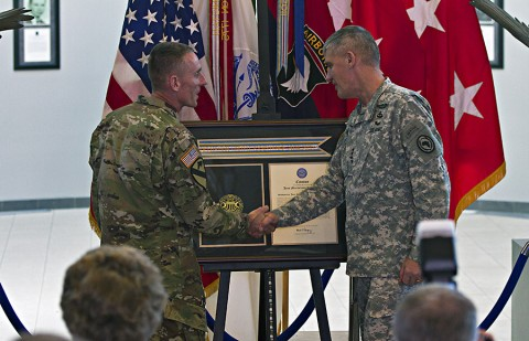 From right: General David M. Rodriguez, commanding general, U.S. Africa Command, and Maj. Gen. Gary J. Volesky, commanding general, 101st Airborne Division (Air Assault) and Fort Campbell, shake hands after unveiling the Joint Meritorious Unit Award during a ceremony at McAuliffe Hall August 27, 2015. (Sgt. William White, 101st Airborne Division Public Affairs)