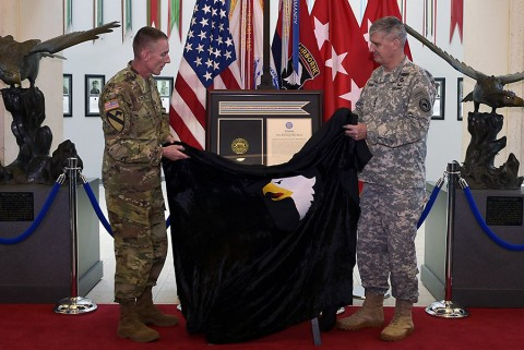 From right: Gen. David M. Rodriguez, commanding general, U.S. Africa Command, and Maj. Gen. Gary J. Volesky, commanding general, 101st Airborne Division (Air Assault) and Fort Campbell, unveil the Joint Meritorious Unit Award during a ceremony at McAuliffe Hall August 27, 2015. (Jerry Woller, Lead VI Specialist-Fort Campbell)