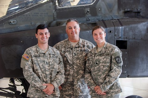 Cadets Daniel Camacho, left, from the U.S. Military Academy at West Point, N.Y. and Olivia Lynch, right, from Embry Riddle Aeronautical University at Daytona Beach, Fla., pose with Sgt. 1st Class Joshua Nichols, the production control noncommissioned officer in charge for Company D, 3rd Battalion, 101st Combat Aviation Brigade, 101st Airborne Division (Air Assault), at Fort Campbell, Ky., Aug. 5, 2015. (Sgt. Duncan Brennan, 101st Combat Aviation Brigade, 101st Airborne Division Public Affairs)