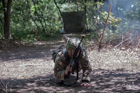 A medic with 3rd Brigade Combat Team, 101st Airborne Division (Air Assault), drops into the prone position during the Expert Field Medical Badge testing here Aug. 1, 2015. The EFMB tests Soldiers' ability to conduct common skills tasks and medical tasks in conditions medics are likely to encounter in the field. Ultimately, only 25 candidates out of more than 185 donned the coveted badge during a ceremony Aug. 6, 2015. (Sgt. Duncan Brennan, 101st Combat Aviation Brigade, 101st Airborne Division Public Affairs)