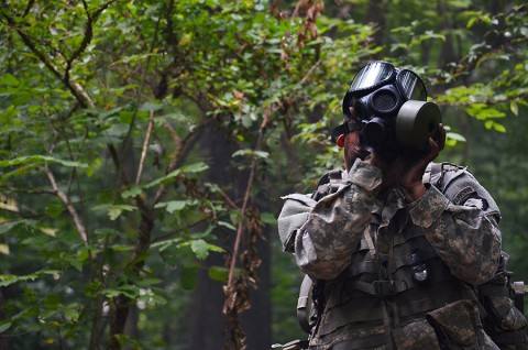 A 1st Brigade Combat Team, 101st Airborne Division (Air Assault) Soldier dons his protective mask while being evaluated during the testing phase of the Expert Field Medical Badge challenge here, Aug. 5, 2015. Chemical, biological, radiological, and nuclear testing is one of the many warrior tasks and drills the medics were evaluated on. (Staff Sgt. Sierra A. Fown, 2nd Brigade Combat Team, 101st Airborne Division Public Affairs)