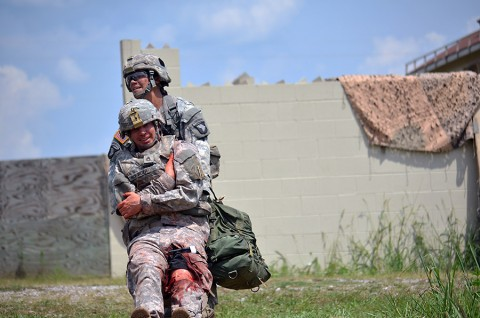 Sgt. Alisa Ryder, Company C, 526th Brigade Support Battalion, 2nd Brigade Combat Team, 101st Airborne Division (Air Assault), performs a one-man carry while being evaluated during the testing phase of the Expert Field Medical Badge challenge here, Aug. 4, 2015. Tactical combat casualty care is one of the many requirements medical personnel need to be proficient in in order to pass the evaluation. (Staff Sgt. Sierra A. Fown, 2nd Brigade Combat Team, 101st Airborne Division Public Affairs)