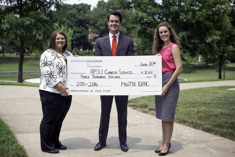 Ryan Smithson presents a $3,000 donation on behalf of the Enterprise Holdings Foundation to Amanda Walker, director of APSU Career Services, and Megan Brown, assistant director of APSU Career Services. (Taylor Slifko/APSU)
