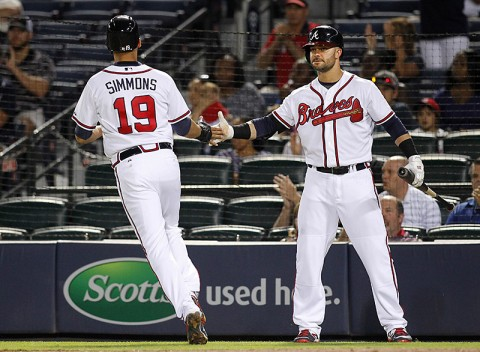 Atlanta Braves shortstop Andrelton Simmons (19) is congratulated by first baseman Nick Swisher   (23) after scoring a run against the Colorado Rockies in the fifth inning at Turner Field. (Brett   Davis-USA TODAY Sports)