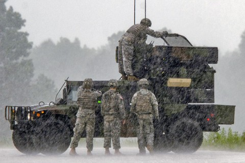 Soldiers with 2nd Battalion, 44th Air Defense Artillery Regiment, 101st Airborne Division (Air Assault) Sustainment Brigade, work on an Avenger air defense system during an Avenger ground gunnery range held Aug. 19 at Fort Campbell, Ky. Despite periods of heavy rain, Soldiers with 2-44 ADA successfully completed their training to become certified on the Avenger systems. (Spc. Joseph Green 101st Sustainment Brigade, 101st Airborne Division (AA) Public Affairs)