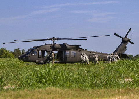 Soldiers with the 58th Signal Company, 101st Special Troops Battalion, 101st Airborne Division (Air Assault) Sustainment Brigade, practice loading casualties into a helicopter for a medical evacuation scenario during a field training exercise in the training area of Fort Campbell, Ky., Aug. 13, 2015.  (Sgt. 1st Class Mary Rose Mittlesteadt, 101st Airborne Division (Air Assault) Sustainment Brigade Public Affairs)