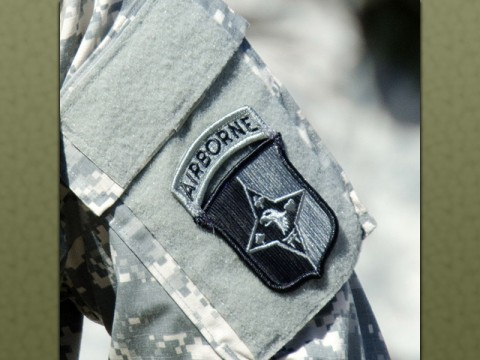 A Soldier wears the 101st Sustainment Brigade, 101st Airborne Division (Air Assault), patch before the brigade cased its colors and uncased new colors in a ceremony to symbolized the brigade's re-designation as the 101st Abn. Div. Sust. Bde., July 30, 2015, at Fort Campbell, Ky. It also served as a patching ceremony, where the Soldiers of the 'Lifeliners' Brigade donned the very familiar 'Old Abe,' the 101st Abn. Div. patch. (Spc. Joseph Green, 101st Sustainment Brigade, 101st Airborne Division (Air Assault) Public Affairs)