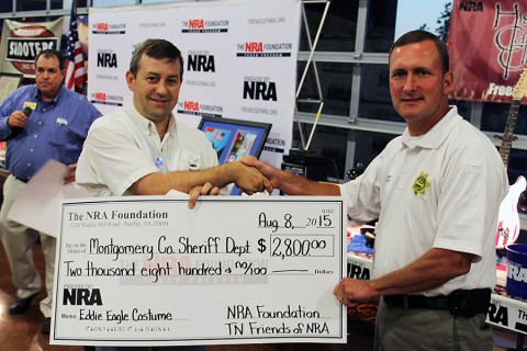Tennessee NRA Field Rep Mike Webb (left) presents a check to Montgomery County Sheriff John Fuson (right).