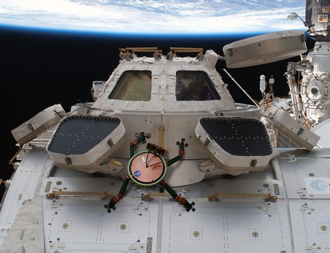 This artist's concept shows how a future robot called LEMUR (Limbed Excursion Mechanical Utility Robot) could inspect and maintain installations on the International Space Station. The robot would stick to the outside using a gecko-inspired gripping system. (NASA/JPL-Caltech)
