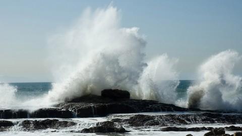 Waves crash against rocks. (Franklin O'Donnell)