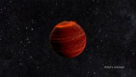 This artist's concept shows an auroral display on a brown dwarf. If you could see an aurora on a brown dwarf, it would be a million times brighter than an aurora on Earth. (Chuck Carter and Gregg Hallinan/Caltech)