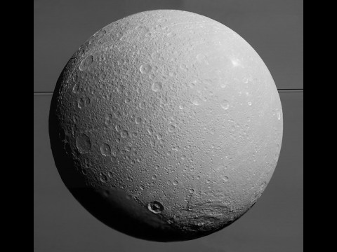 This view from NASA's Cassini spacecraft looks toward Saturn's icy moon Dione, with giant Saturn and its rings in the background, just prior to the mission's final close approach to the moon on August 17, 2015. (NASA/JPL-Caltech/Space Science Institute)