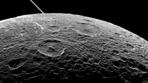 A view of Saturn's moon Dione captured by NASA's Cassini spacecraft during a close flyby on June 16, 2015. The diagonal line near upper left is the rings of Saturn, in the distance. (NASA/JPL-Caltech/Space Science Institute)