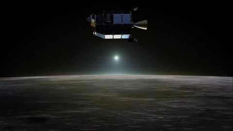 Artist's concept of NASA's Lunar Atmosphere and Dust Environment Explorer (LADEE) spacecraft in orbit above the moon. (NASA Ames / Dana Berry)