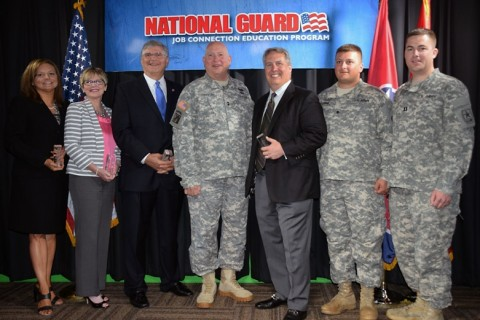 """Maj. Gen. Max Haston, The Adjutant General of Tennessee, recognizes the 3000th hire through the JCEP program.  Seen here (left to right) with Jann Dower, Melinda Kelsey, and Commissioner Burns Phillips of the Tennessee Dept. of Labor and Workforce Development, Haston, Steve Brophy of Dollar General, Spc. Josh De Roisa, and Capt. Michael Riley, National Guard Bureau."""