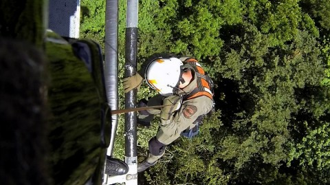 Tennessee Highway Patrol Aviation Division trooper descends to rescue injured hiker. (THP)