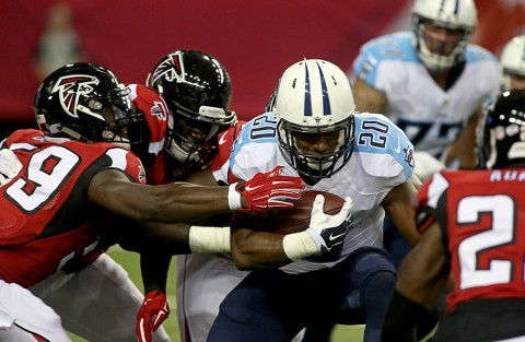 Tennessee Titans running back Bishop Sankey (20) gets tackled by Atlanta Falcons linebacker Joplo Bartu (59) and others in the first quarter of their preseason NFL football game at Georgia Dome. (Jason Getz-USA TODAY Sports)