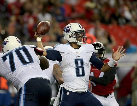 Tennessee Titans quarterback Marcus Mariota (8) passing against the Atlanta Falcons during the first quarter of their preseason   NFL football game at the Georgia Dome. (John David Mercer-USA TODAY Sports)