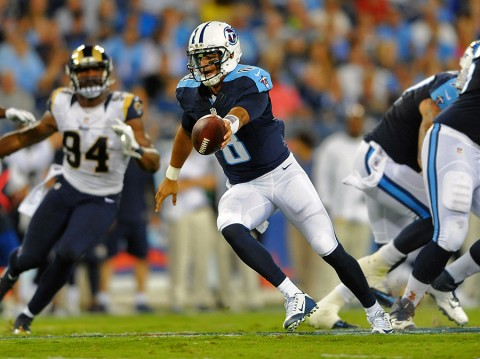 Tennessee Titans quarterback Marcus Mariota (8) fakes the hand off during the first half against the St. Louis Rams at Nissan Stadium. (Christopher Hanewinckel-USA TODAY Sports)