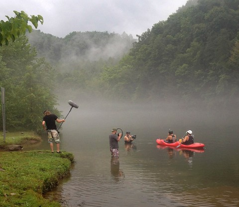 "The ""Tennessee Uncharted"" crew films a segment with host Erick Baker (front, in canoe). The program, which launched late in 2014, won first place for an outdoors series as awarded by the Association for Conservation Information (ACI)."