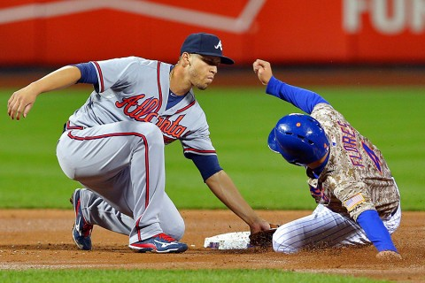 Atlanta Braves shortstop Andrelton Simmons (19) tags out New York Mets shortstop Wilmer Flores (4) on a steal attempt during the second inning at Citi Field. (Brad Penner-USA TODAY Sports)